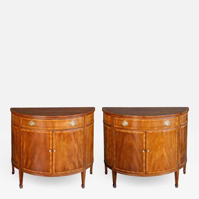 A Shapely Pair of English Edwardian Mahogany Cabinets