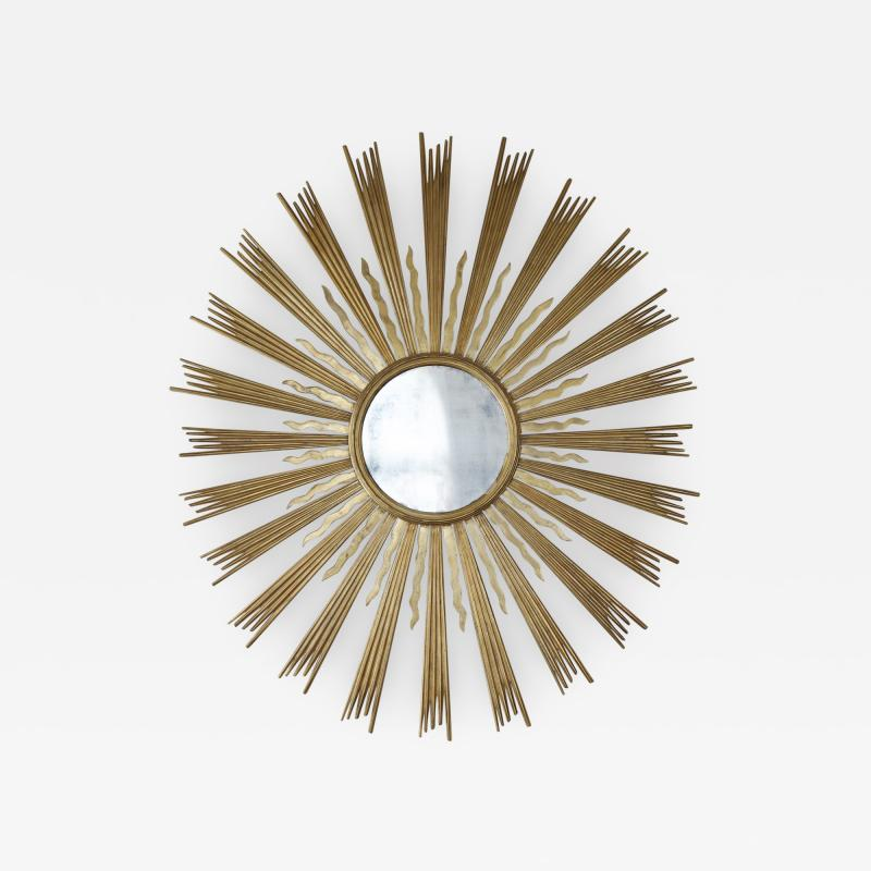 A Spectacular Large Sunburst Circular Mirror In Two Colors Of Gilding