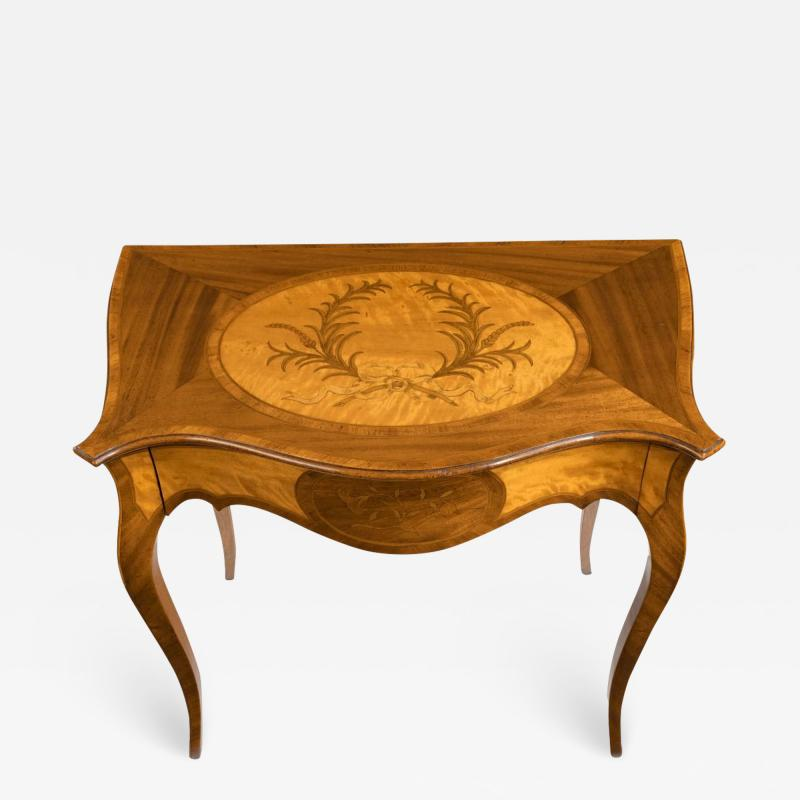 A Victorian inlaid satinwood and kingwood table in the style of Hepplewhite