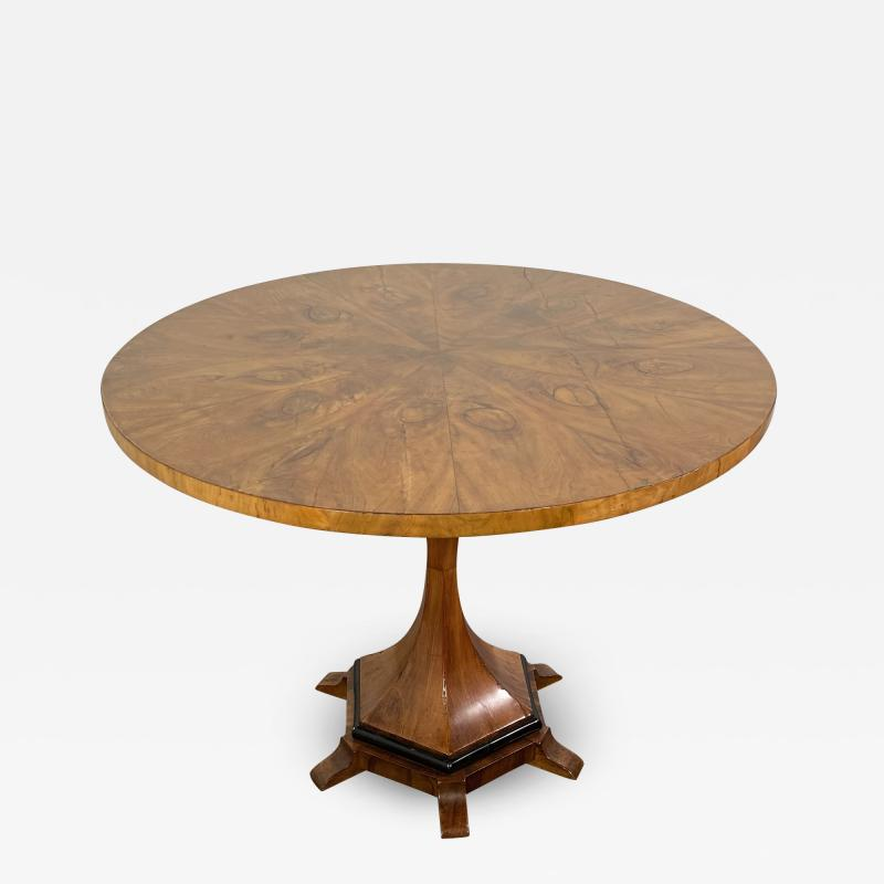 A Viennese Biedermeier Figured Fruitwood Walnut and Ebonized Center Table