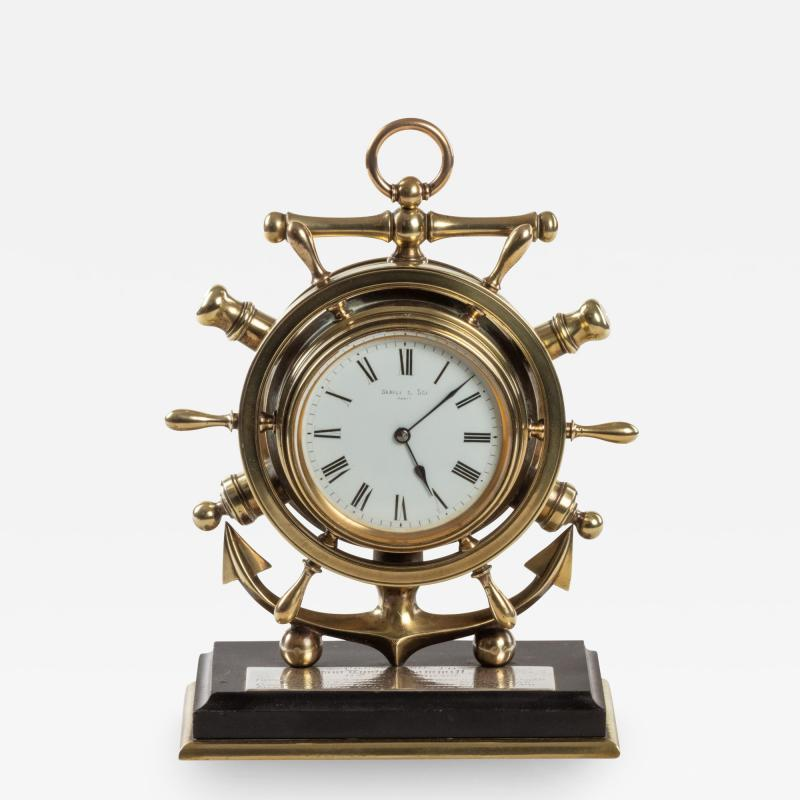 A brass ship s novelty clock presented to Captain Tynte F Hammill RN