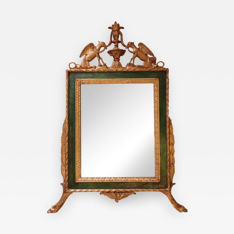 A carved and gold wall mirror Italy XIXth century