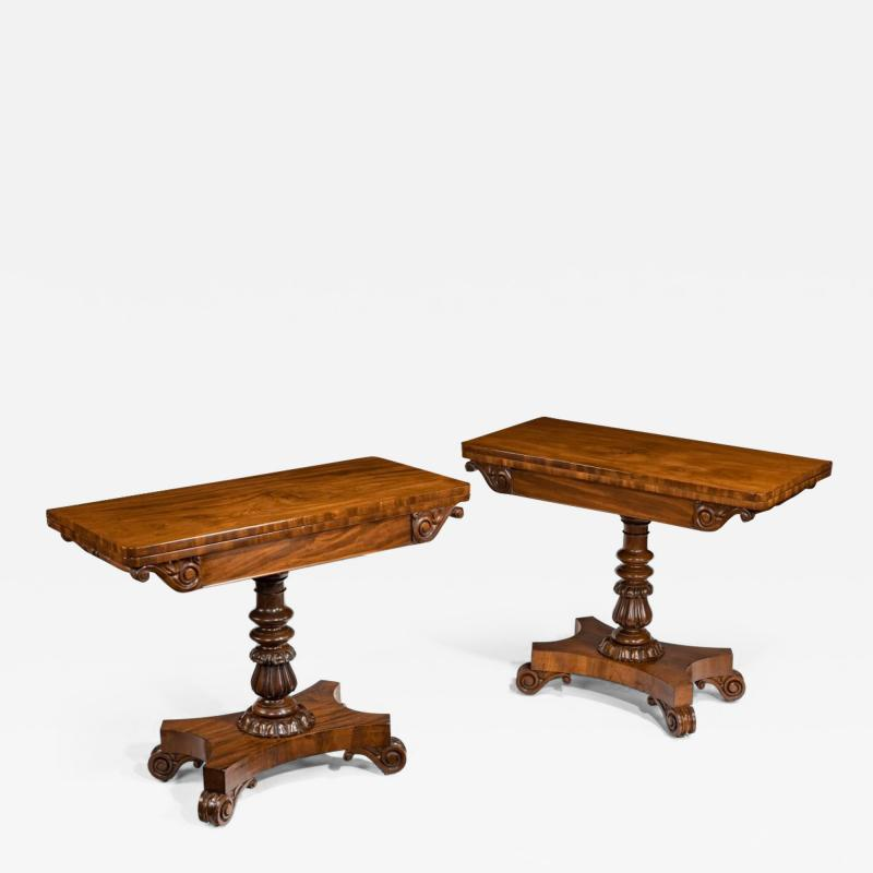 A companion pair of William IV flame mahogany card tables