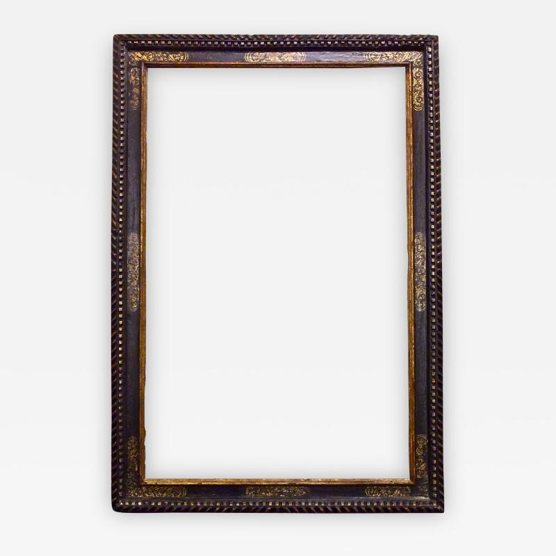 A dramatically large carved gilded and polychrome Spanish Baroque period frame