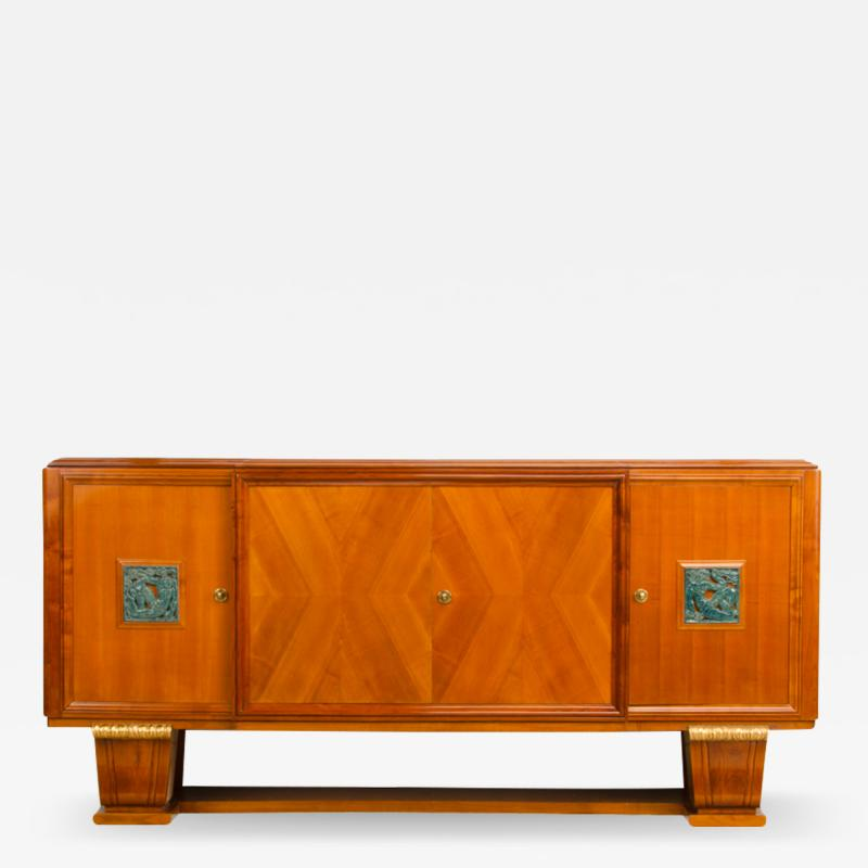 A fine French 1940s walnut veneer with gilded carved wood details sideboard