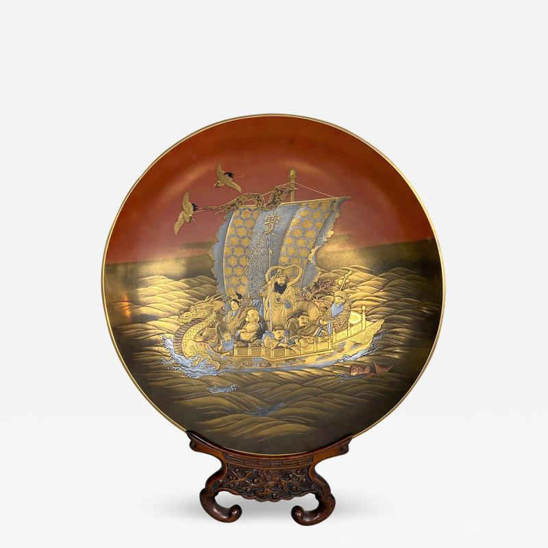 A fine lacquer dish depicting the Lucky Gods aboard the Takarabune