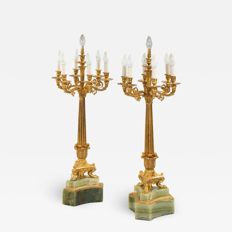 A large pair of onyx and ormolu lamps