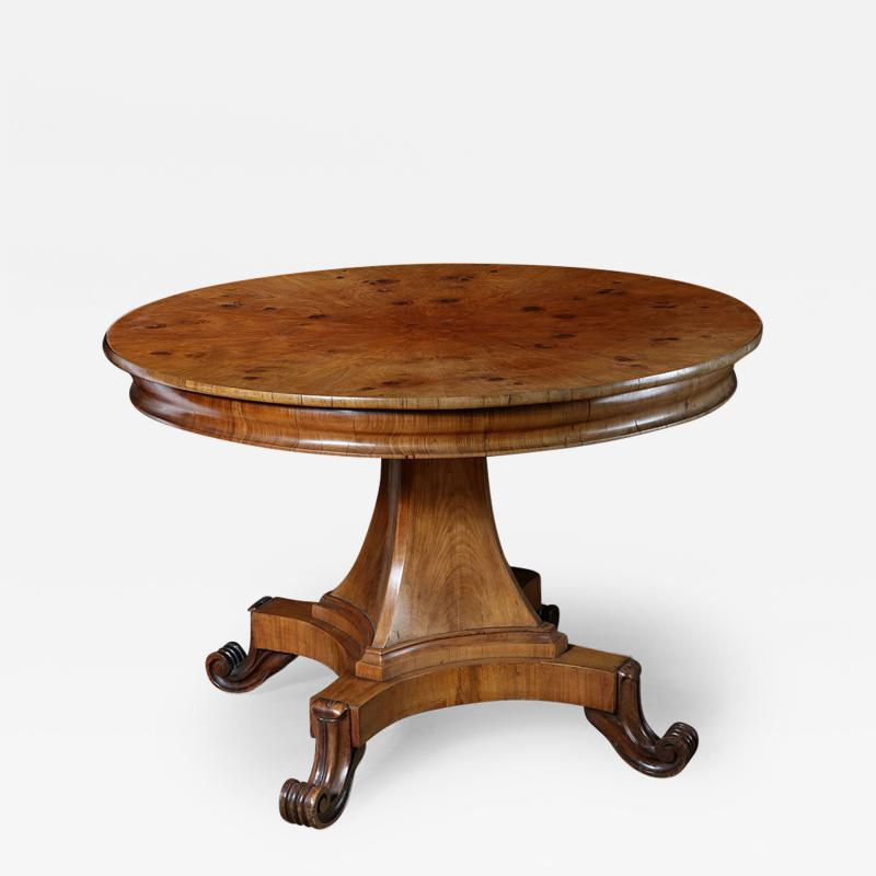 A mid 19th century walnut gueridon table