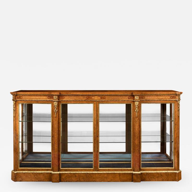 A mid Victorian burr walnut display cabinet