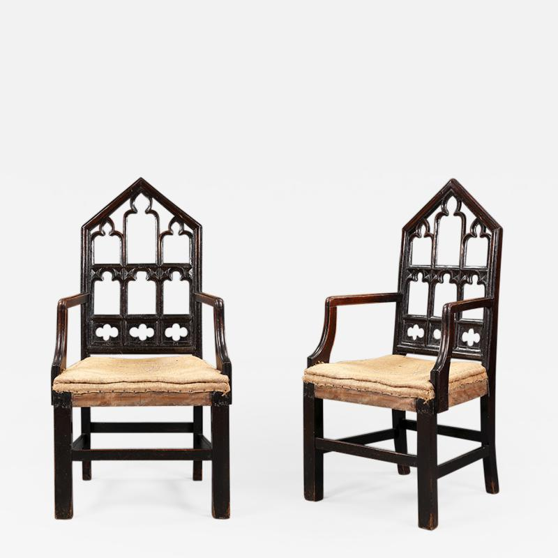 A pair of Gothic hall chairs