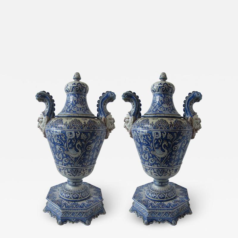 A pair of Italian Baroque Style Covered Vases On Stands 19th C
