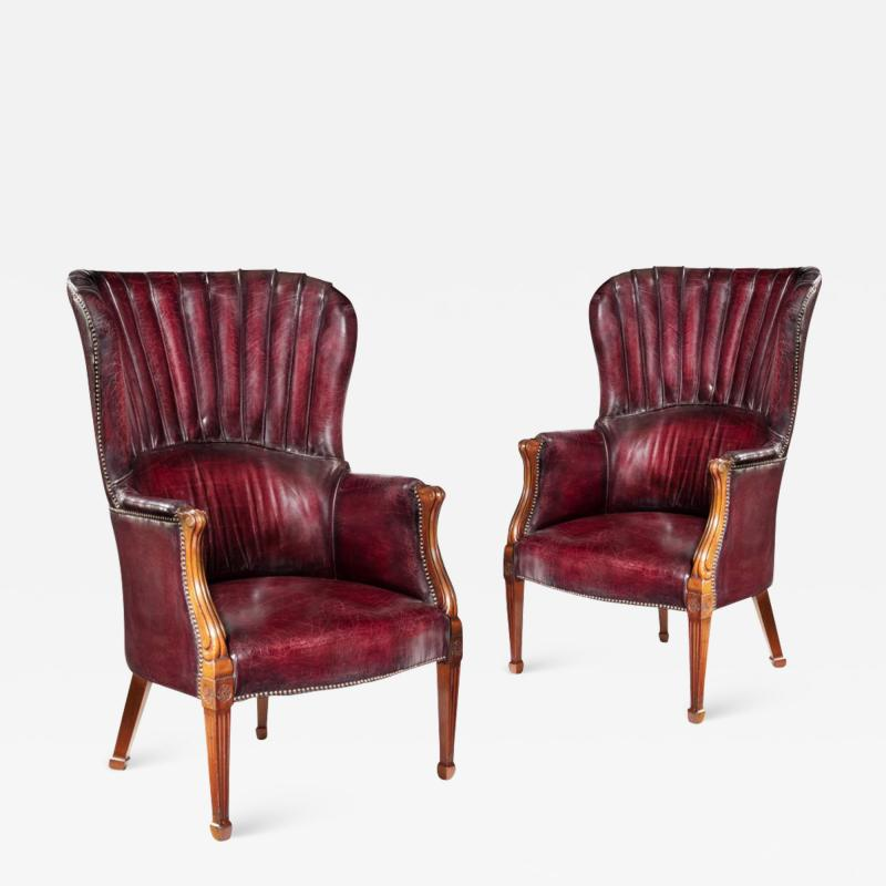 A pair of barrel backed Mahogany wing arm chairs