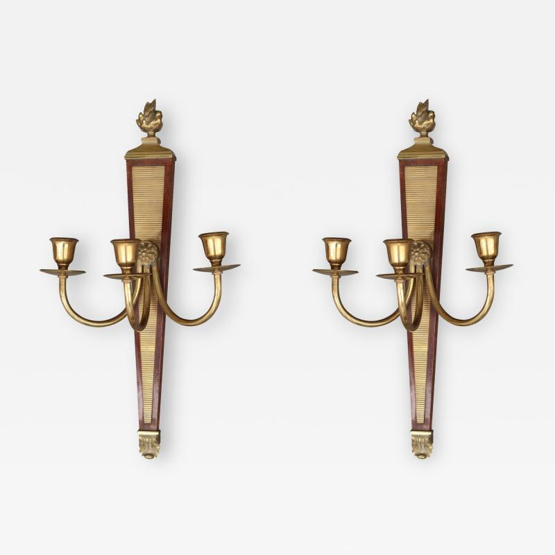 A pair of bronze and wood sconces France XIXth century