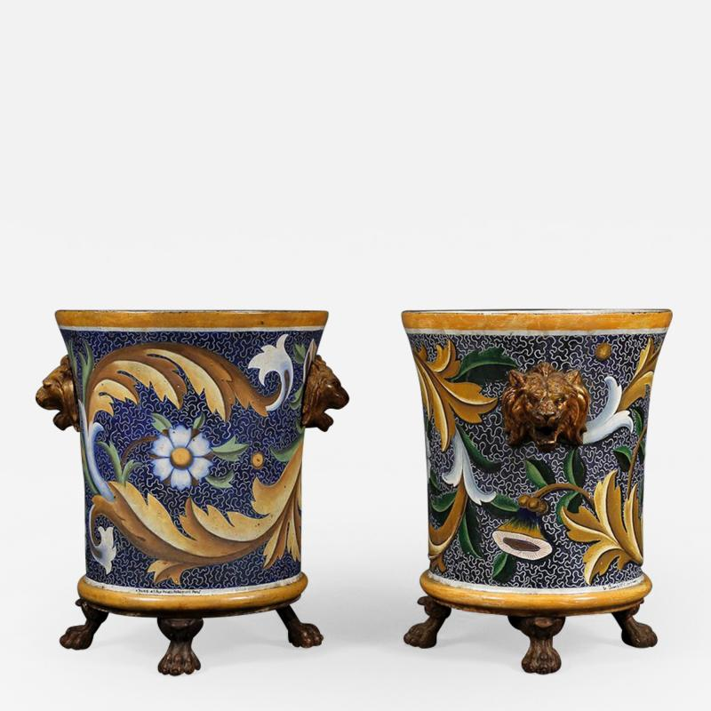 A pair of enamel painted cast iron jardiniers
