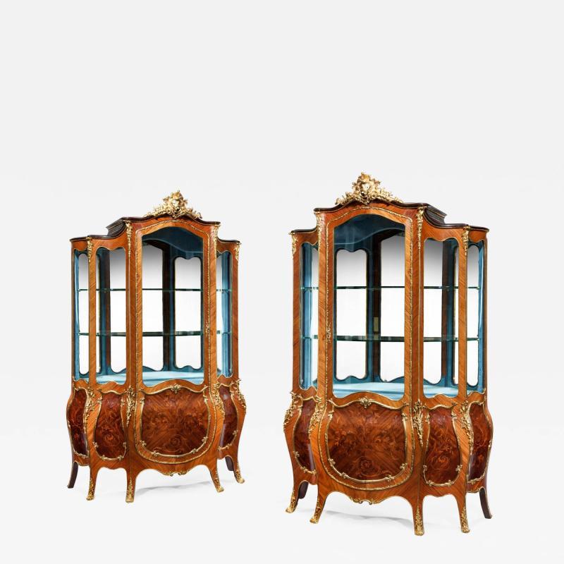 A pair of exhibition quality Napoleon III kingwood vitrines