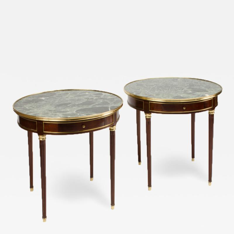 A pair of mahogany and brass gueridon tables Directoire style circa 1940