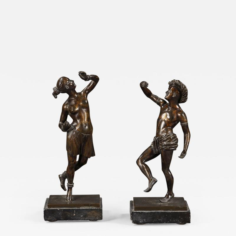 A pair of mid 19th century dancing bronze figures