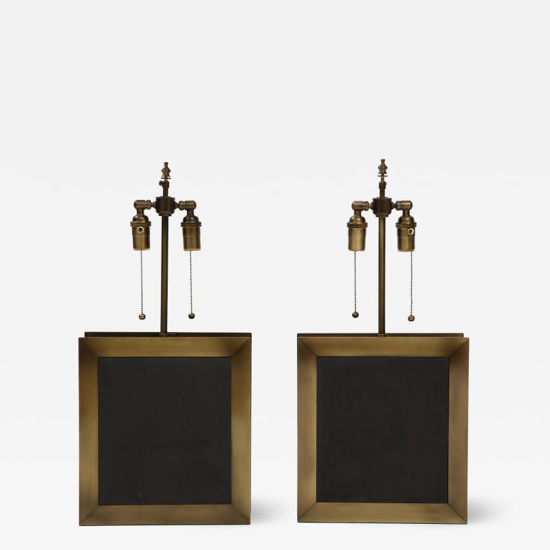 A pair of square shaped lamps made of ardoise cliv e and a bronze frame