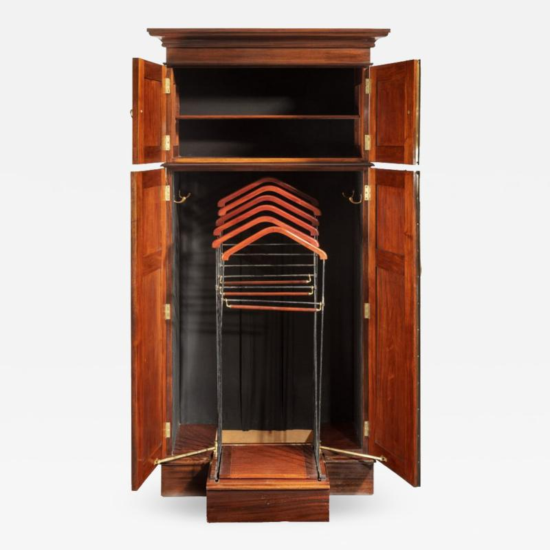 A rare Edwardian mahogany mechanical gentleman s wardrobe
