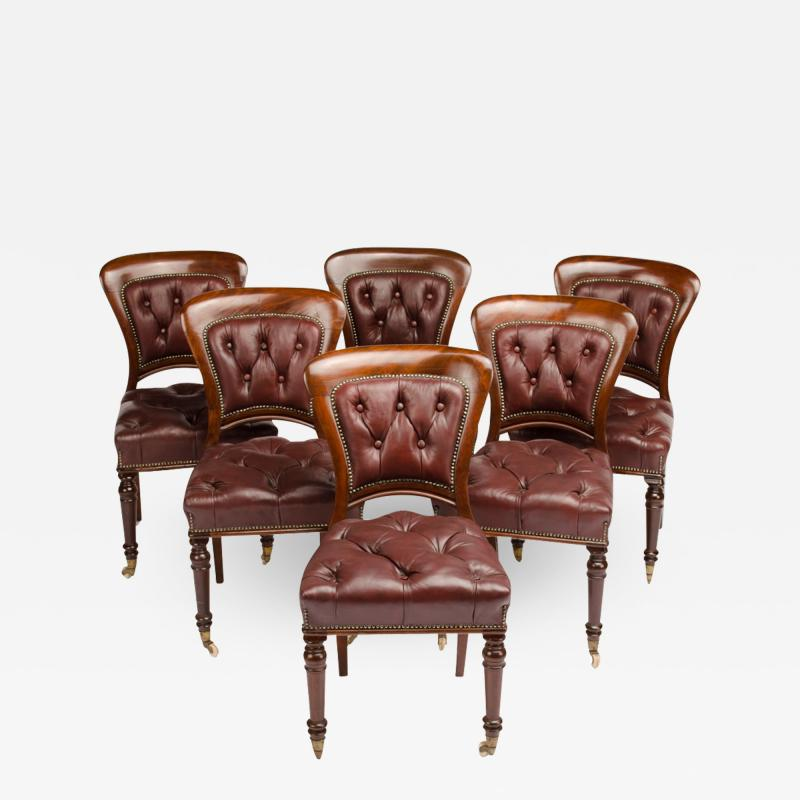 A set of six 19th Century Irish walnut and leather dining chairs