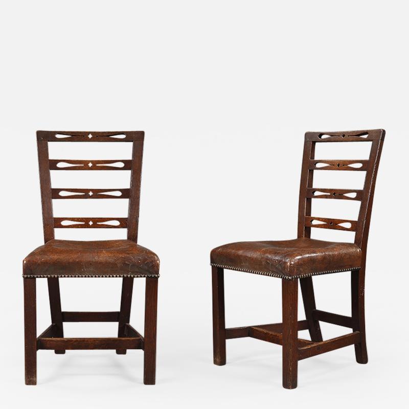 A set of six George III oak dining chairs