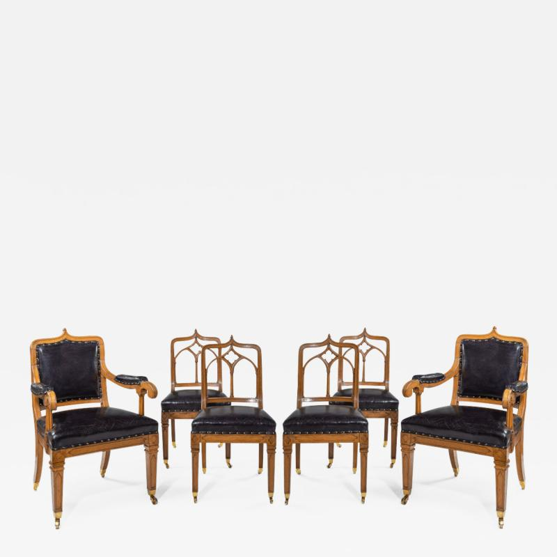 A set of six Gothic oak dining chairs