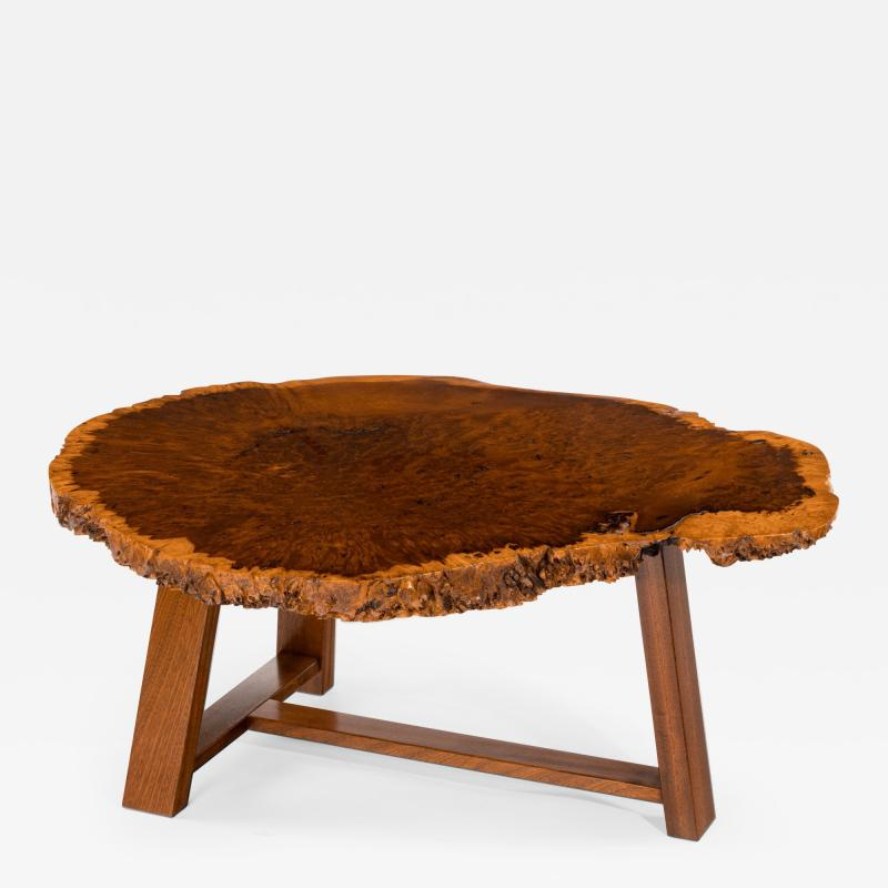 A stylish polished Amboyna Coffee Table