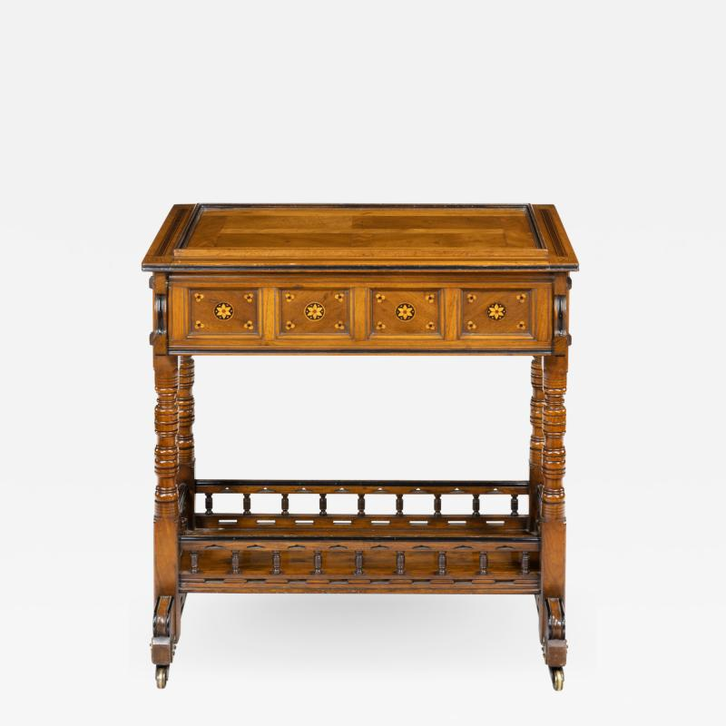 A walnut side table jardini re by Gillows probably after Augustus Pugin