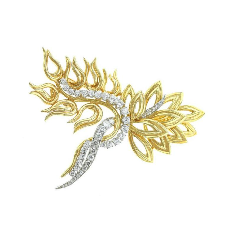 ABSTRACT 18K YELLOW GOLD PLATINUM AND DIAMOND PIN RETAILED BY HARRY WINSTON