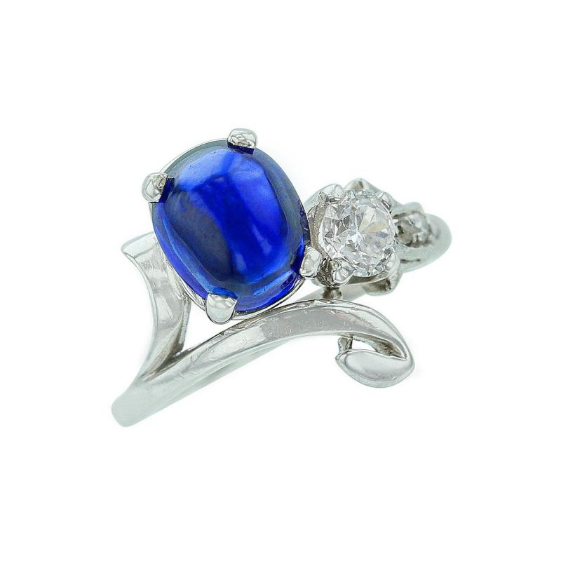 ANTIQUE OVAL BLUE SAPPHIRE CABOCHON AND WHITE DIAMOND RING