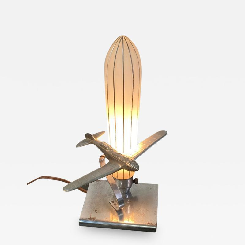 ART DECO AIRPLANE AND GLASS ZEPELLIN LAMP