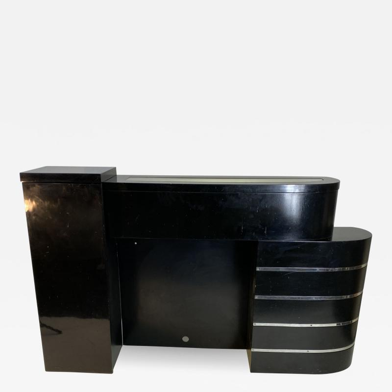 ART DECO ASYMMETRICAL FIREPLACE WITH CURVED CHROME BAND DESIGN