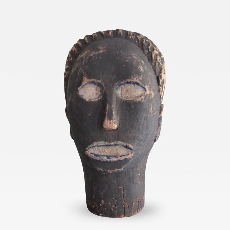 African American Carved Black Head with Blue
