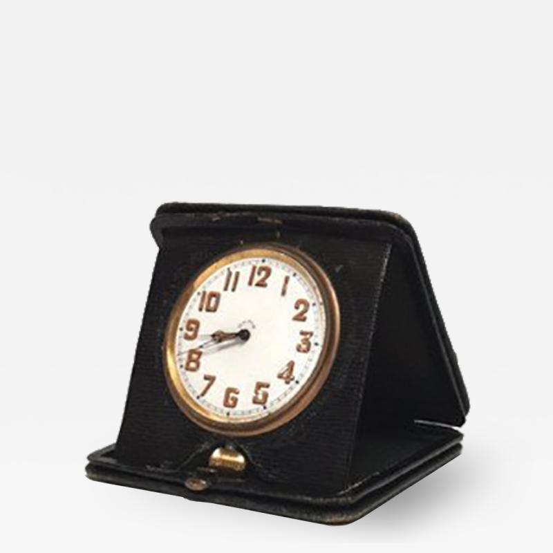An Art Deco Travel Clock in Green Leather