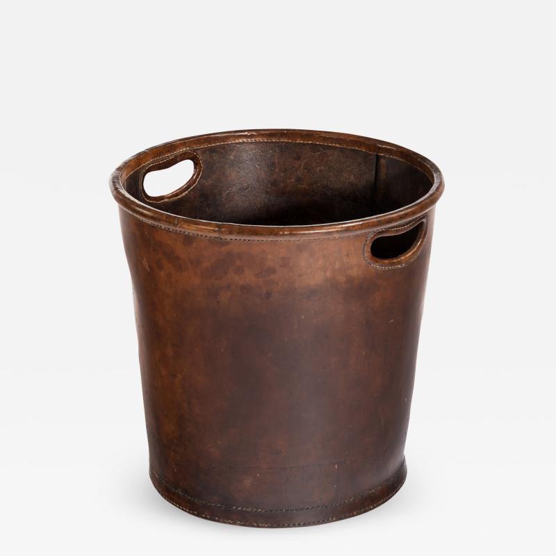 An Edwardian leather paper bucket