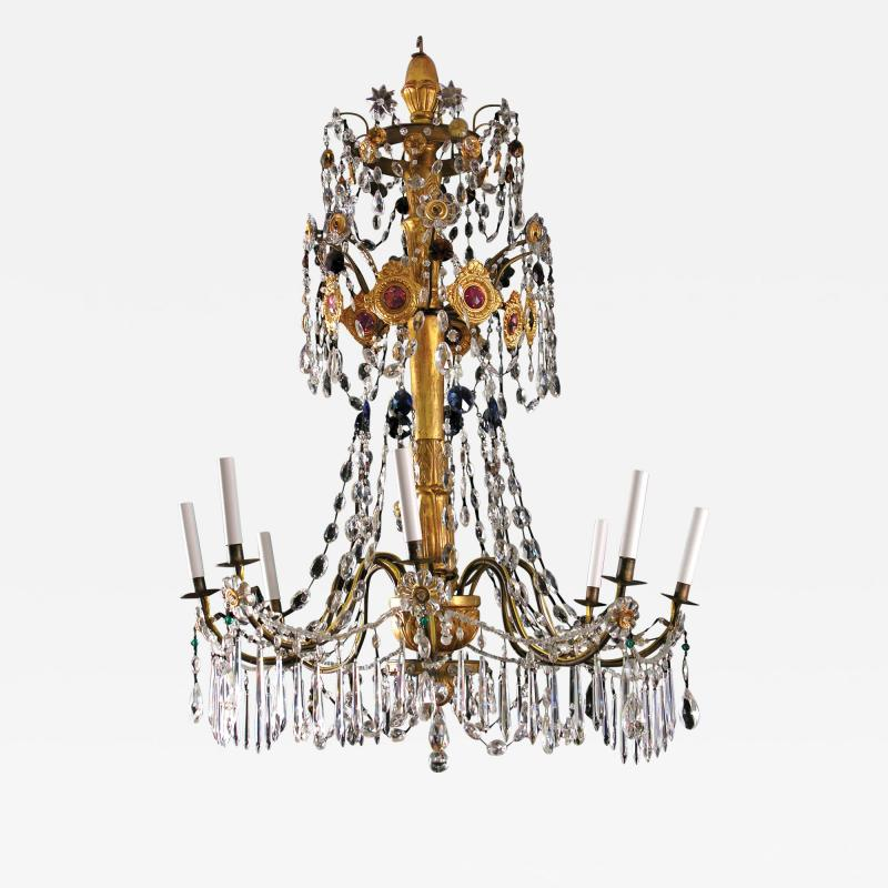 An Eight Light Carved and Gilded Wood Chandelier with Colored Crystals