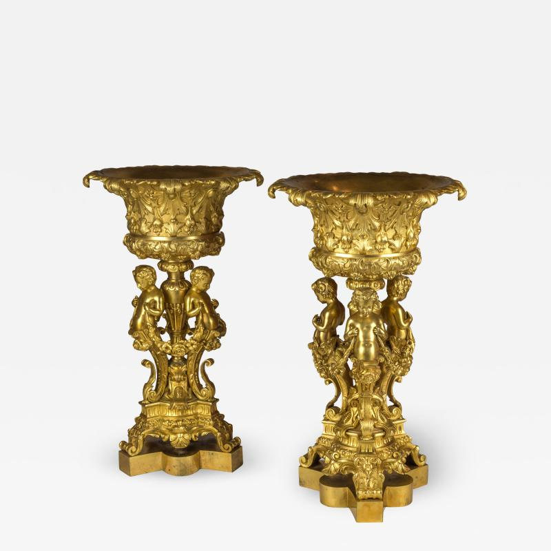 An Elaborate Pair of Figural Gilt Bronze Tazzas Supported by Three Cherubs