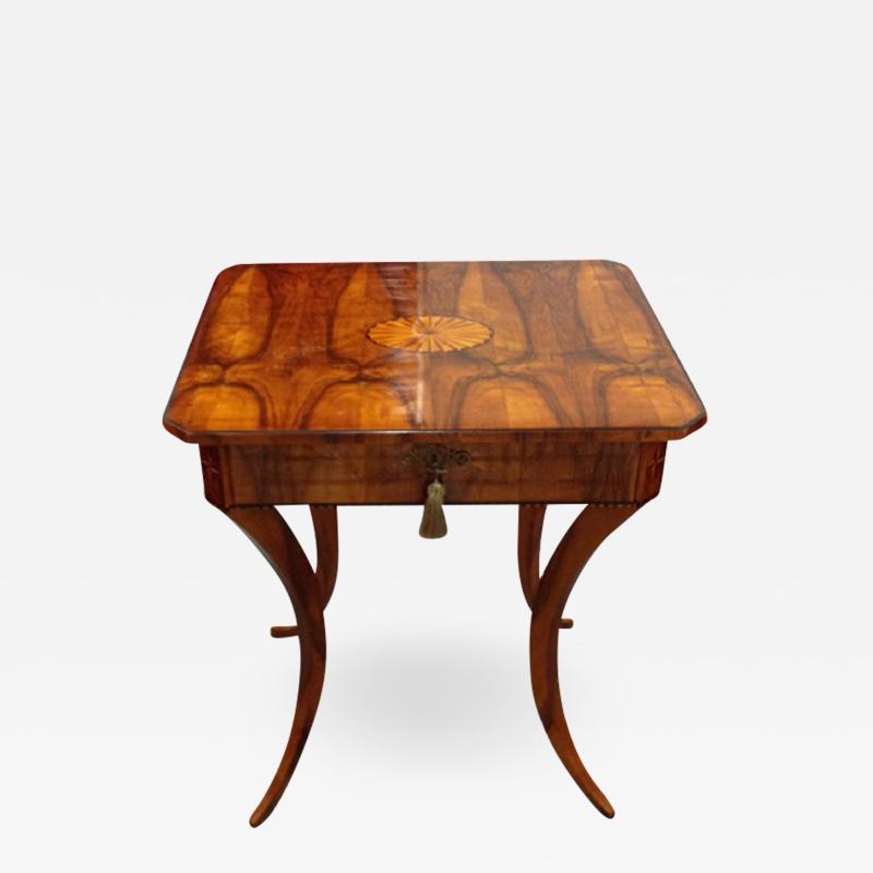 An Elegant Biedermeier Single Drawer Sewing Table