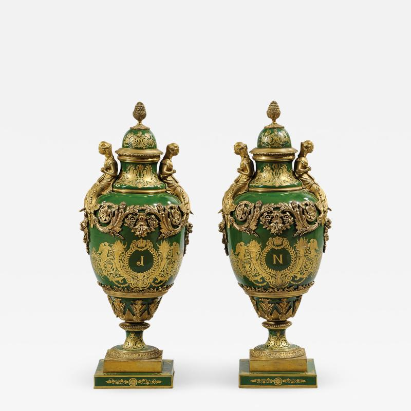 An Important Pair of S vres style Porcelain Urns and Cover