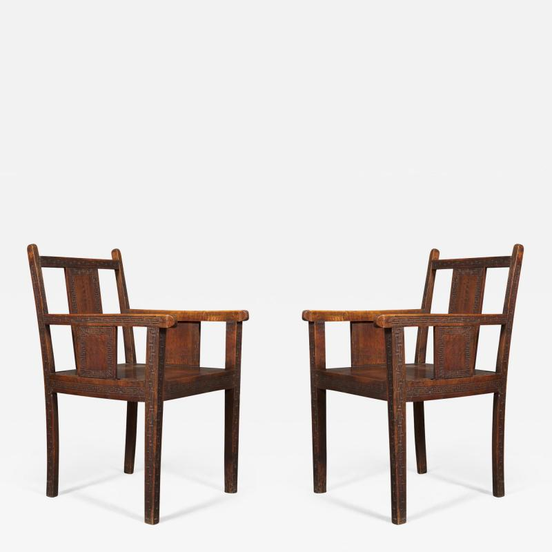 An Pair of Oak Aesthetic Period Armchairs Carved with Greek Mey Motifs