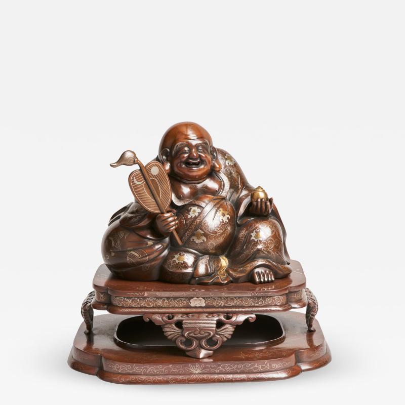 An antique Japanese bronze Okimono of Hotei
