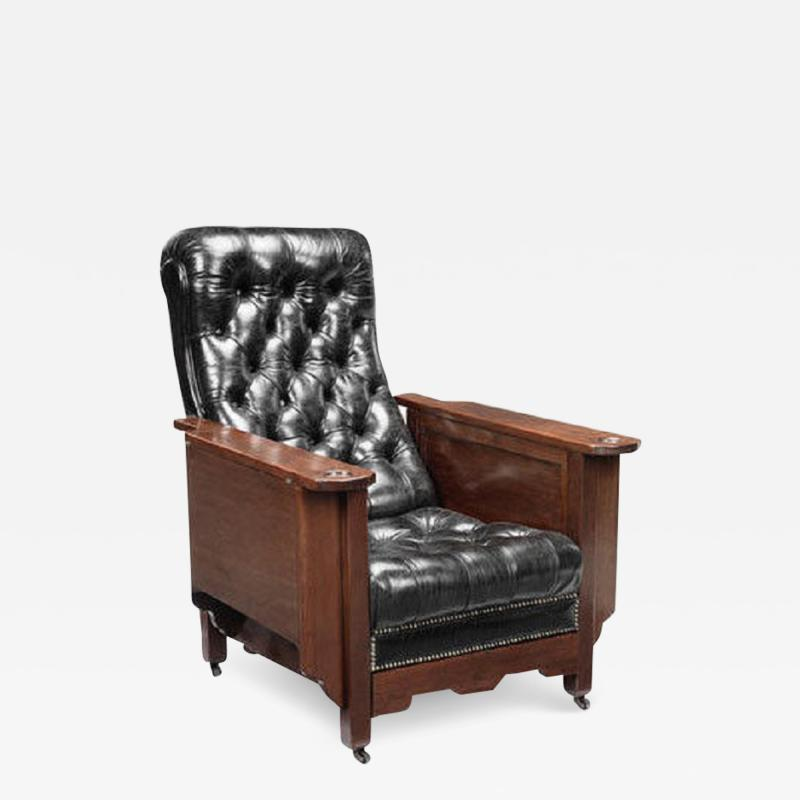 An early 20th century mahogany Glenisters patent reclining gaming