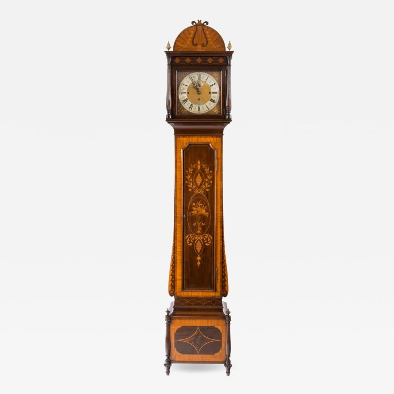 An unusual flame mahogany long case clock attributed to Maples