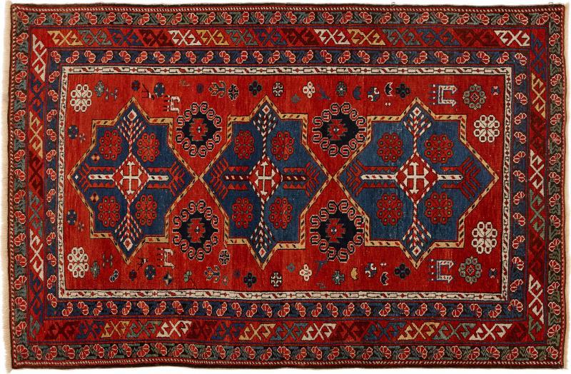 Antique Caucasian hand woven wool rug