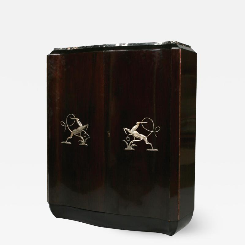 Art Deco shaped cabinet with silvered metal decoration