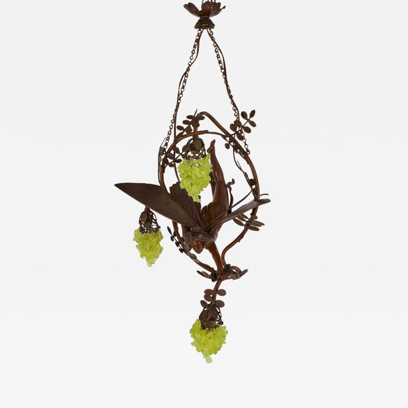 Art Nouveau period bronze and coloured glass chandelier