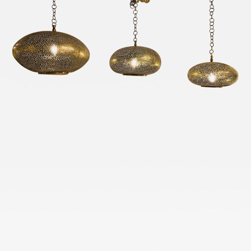 Atlas Showroom Set of Three Oval Shaped Brass Pendant Chandeliers in Graduating Sizes
