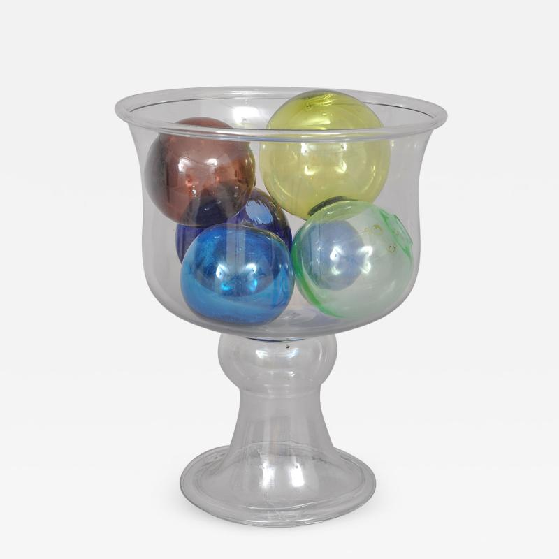BLOWN FISH BOWL WITH A GROUP OF SIX BLOWN WITCH BALLS AND PACKING BALLS