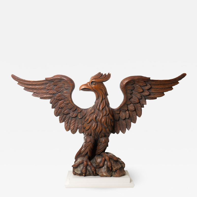Carved wooden eagle with wings spread