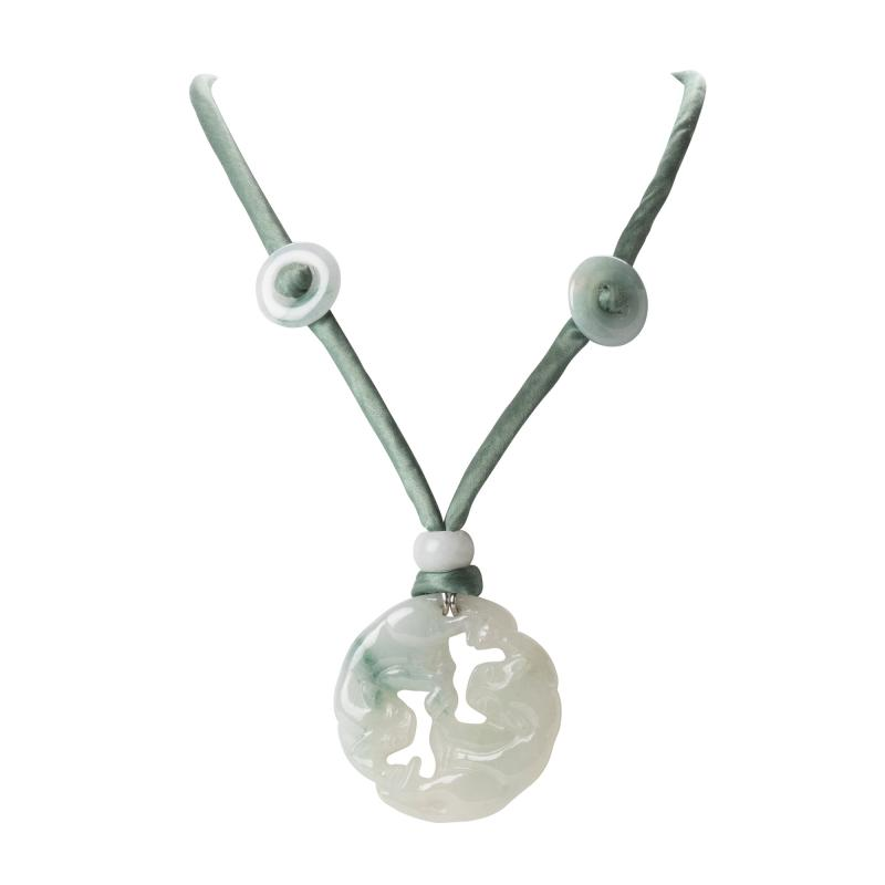 Celadon jade circular carved and pierced pendant necklace